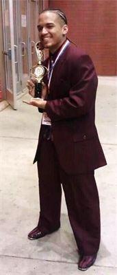 Jose posing with Gospelfest awards