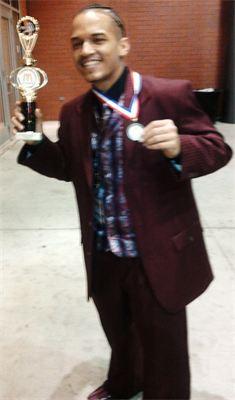 Jose holding awards from Gospelfest