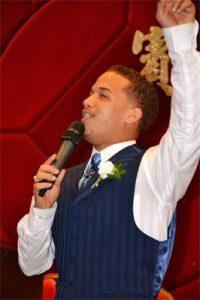 Jose singing with blue vest