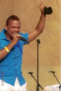 Jose singing and pointing during concert