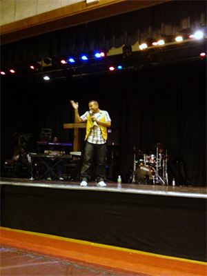 Jose performing with yellow vest