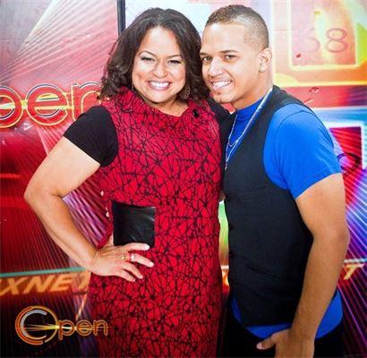 Fan wearing red dress posing with Jose